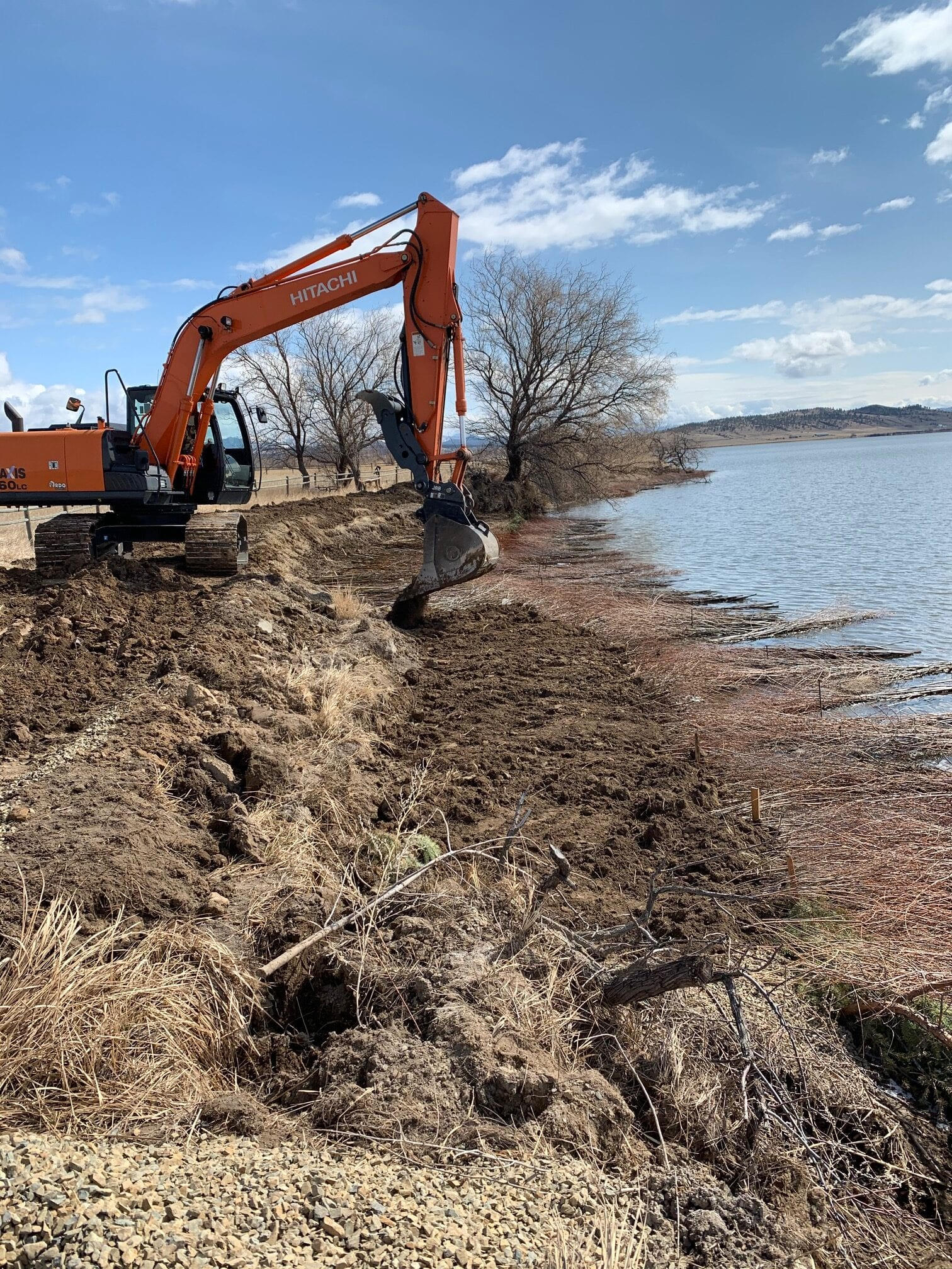 Excavator working on a double willow soil lift-Lake Helena Montana