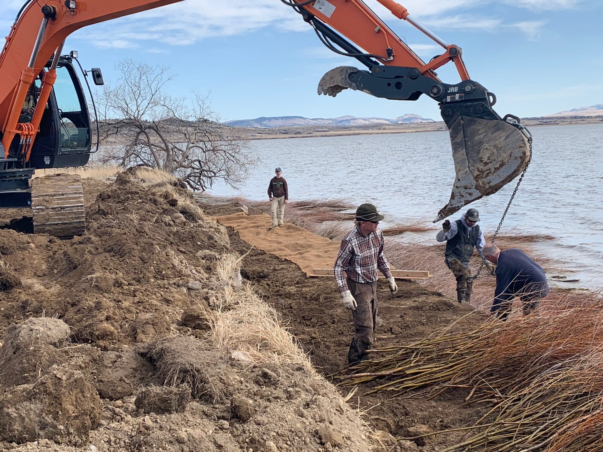 Lewis and Clark Conservation District staff and chairman and other volunteers helping on a double willow soil lift, Lake Helena, Montana